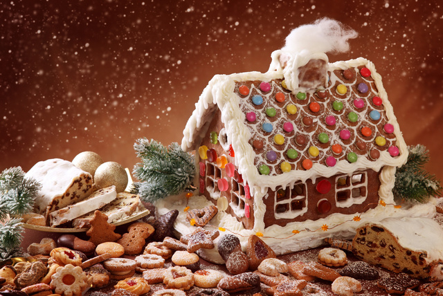 Homemade gingerbread house and christmas cakes
